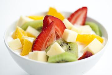 fruit salad with chunks of fruit and yogurt