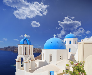 Blue domed church in Oia village on Santorini island