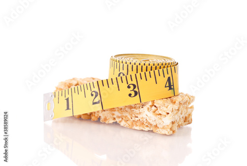 Tape Measure on top of Healthy Snack Cereal Bar