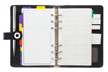 Personal black organizer with pen.