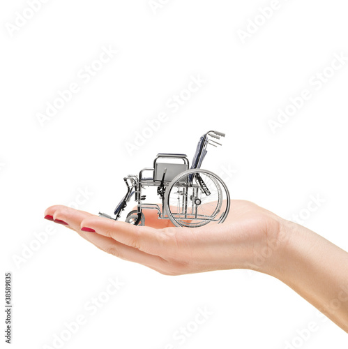 Woman's hand holding a wheelchair