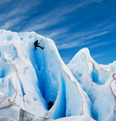 Two men climbing a glacier in patagonia.