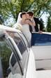 Newlywed Couple Standing Beside Limousine