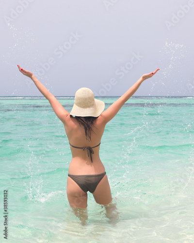 young woman in sea with open hands