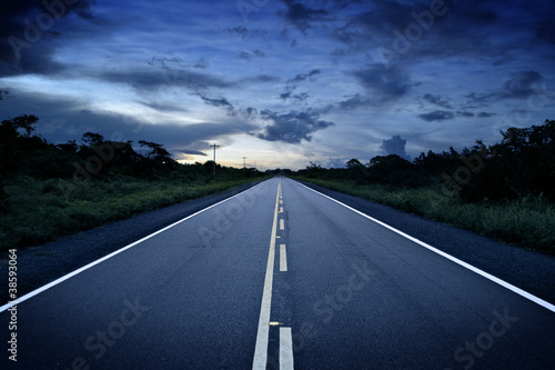 Remote road at sunset
