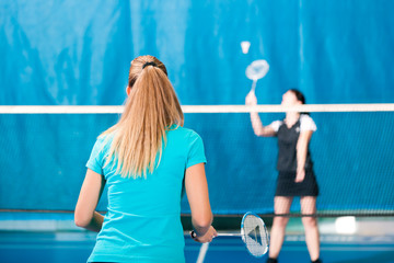 Badminton sport in gym, women playing
