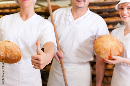 Baker with his team in bakery