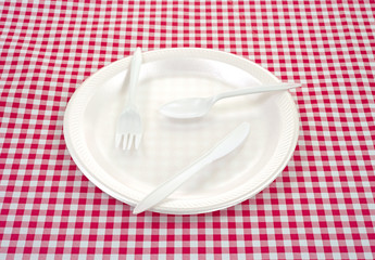 Plastic silverware on plate