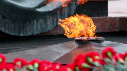 Eternal fire on memorial grave of Unknown soldier