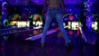 girl throws bowling ball and unusual way and misses aim in club
