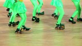 Several girls dance, only legs are visible