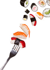 Sushi pieces falling on fork, isolated on white background