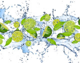 Fototapety Fresh limes in water splash,isolated on white background