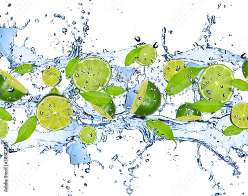 Poster Opspattend water Fresh limes in water splash,isolated on white background