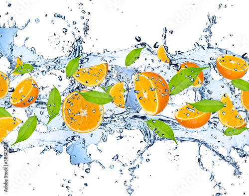 Fresh oranges in water splash,isolated on white background