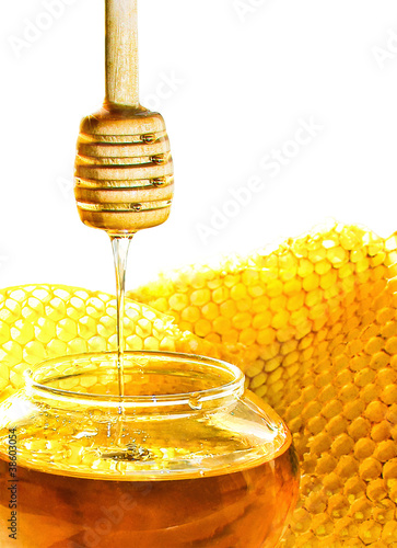 Honey dipper with bee honeycomb isolated on white