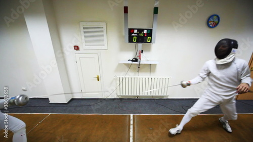 Boy does girl prick in training sword fencing at club
