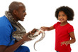 Vet and Preschool Child Snake Owner Helping Pet