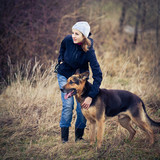 Master and her obedient (German shepherd) dog poster