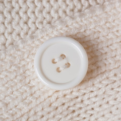 High Resolution knitted texture with a white button background