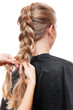 hairdresser doing up one's hair in a plait
