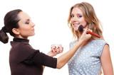 make-up artist doing make-up with brush