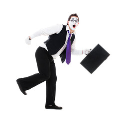 mime with hand luggage running