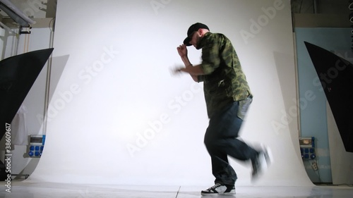Guy-rapper poses for photographer in studio