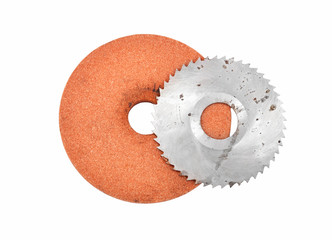 Grinding disc and circular saw blade, isolated on white