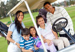 Family in a golf cart