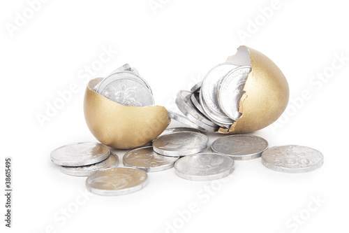 Golden egg with coins