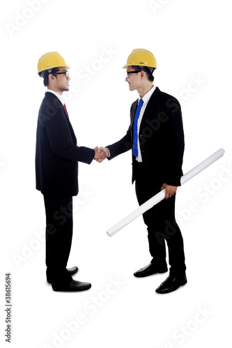 Engineers hand shake isolated on white