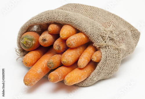 carrots in a burlap bag