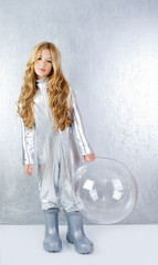 Astronaut girl with silver uniform and glass helmet