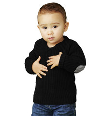portrait of adorable kid touching his stomach against a white ba
