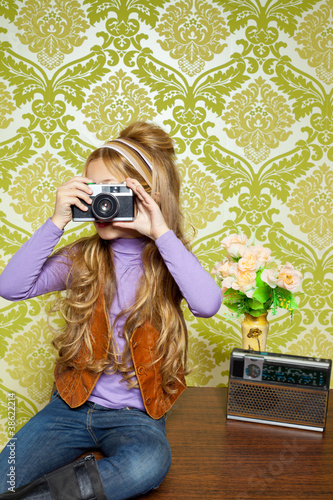 hip retro little girl shooting photo on vintage camera