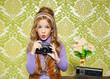 hip retro little girl shooting photo on vintage camera