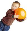 portrait of funny kid holding a big orange balloon over white ba