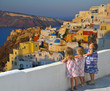 Little girls watching the sunset over Oia village - Greece