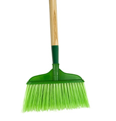 green broom on a white background