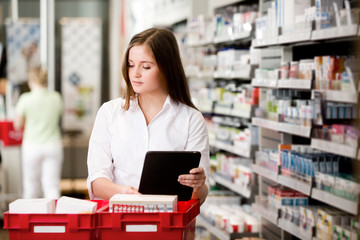 Female Pharmacist with Digital Tablet