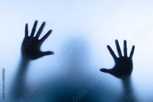 blur hand of man touching glass