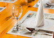 Glasse and plate on table in restaurant
