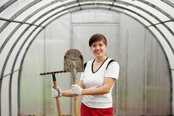 Happy  gardener  in hothouse