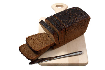 Rye bread and knife on a wooden board