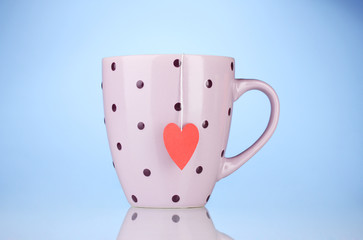 Pink cup and tea bag with red heart-shaped label