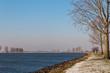 Curved Dutch river in wintertime