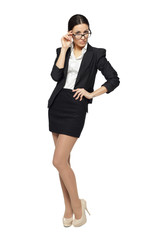 Full length of young business woman standing