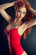 Slim attractive female in red lingerie