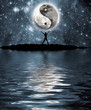 Man in front of moon with the sign of the yin and yang